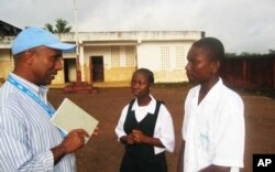 UNICEF official talking to students in Ganta, Liberia