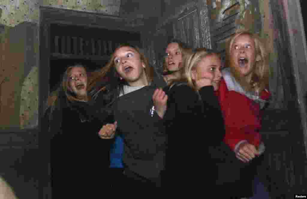 "A group of girls react to a live actor character at the ""13th Floor"" haunted house in Denver , Colorado, USA, Oct. 18, 2013."