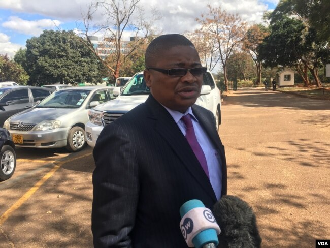 FILE - Harrison Nkomo from Zimbabwe Lawyers for Human Rights, who is representing Pastor Evan Mawarire, speaks to reporters in Harare, Zimbabwe, June 28, 2017. (S. Mhofu/VOA)