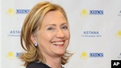 Secretary of State Hillary Rodham Clinton shake hands during their meeting at the sidelines ofat the start of OSCE.