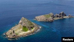 A group of disputed islands, known as Senkaku in Japan and Diaoyu in China is seen in the East China Sea (Reuters/Kyodo file photo)