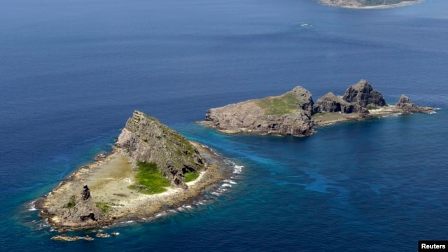 FILE - Part of a group of disputed islands, Minamikojima (bottom) and Kitakojima, known as Senkaku in Japan and Diaoyu in China, seen in the East China Sea, in this photo taken by Kyodo.