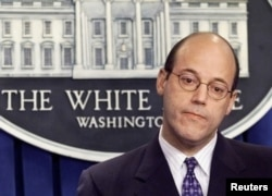 FILE - White House Press Secretary Ari Fleischer listens to a question duringa briefing at the White House in Washington, April 9, 2003.