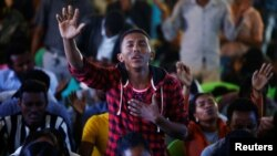 A man attends a prayer session at Biftu Bole Lutheran Church during a prayer and candle ceremony for protesters who died in the town of Bishoftu two weeks ago during Irreecha, the thanksgiving festival of the Oromo people, in Addis Ababa, Ethiopia, Oct. 1