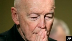 FILE - Cardinal Theodore McCarrick prays during the United States Conference of Catholic Bishops' annual fall assembly in Baltimore, Nov. 14, 2011.