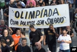 Police protest their pay in late June, just weeks before the opening of the Rio Olympics.