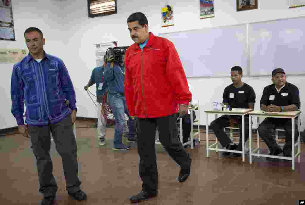Venezuela's President Nicolas Maduro arrives at a polling station to vote.