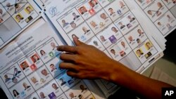 An electoral worker counts ballots at a polling station in Guatemala City, Sunday, Sept. 6, 2015.