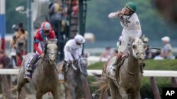 Irad Ortiz Jr., riding Creator, celebrates after winning the 148th running of the Belmont Stakes horse race in Elmont, N.Y., June 11, 2016.