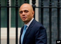 FILE - Government Cabinet Minister Sajid Javid arrives for a meeting at 10 Downing Street in London,Oct. 10, 2017.