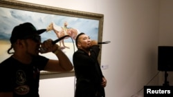 Hip-hop singers Battogtokh Odsaikhan (L) and Sanjjav Baatar of a band called Fish Symboled Stamp perform in an art gallery in Ulaanbaatar, Mongolia, June 23, 2017.