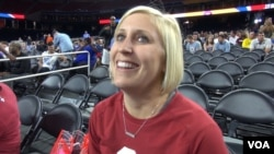 Carlee Daub of Norman, Oklahoma, is thrilled at the prospect of watching her Oklahoma Sooners play in the Final Four, and she has a special connection to the team: She's married to one of the coaches. (G. Flakus/VOA)