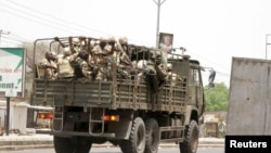 FILE - Soldiers are seen on a truck along a road in Maiduguri in Borno State, Nigeria, May 14, 2015.