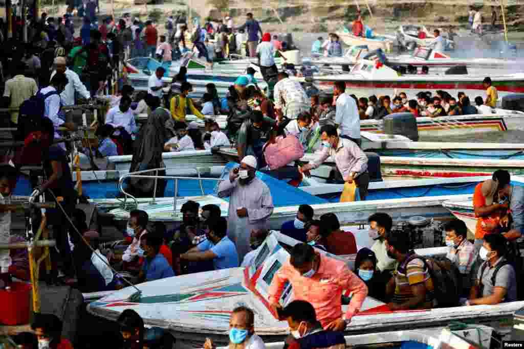 Karantin e'lon qilinib, mehnat muhojirlari uyiga qaytmoqda. Bangladesh.