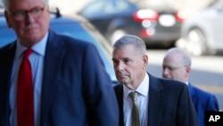 ژنرال بازنشسته جیمز کارترایت در حال ورود به یکی از جلسات دادگاه