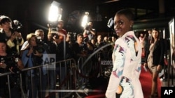 "Paparazzi photograph actress Lupita Nyong'o as she arrives at a screening of ""12 Years A Slave"" in Los Angeles, California."