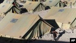 Suriyalik qochqinlar lageri, Livan bilan chegaradagi Arsal shahri.