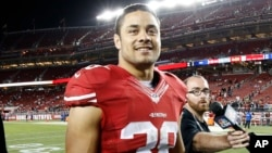 FILE - San Francisco 49ers running back Jarryd Hayne (38) walks off the field after an NFL preseason football game against the San Diego Chargers in Santa Clara, Calif., Sept. 3, 2015.