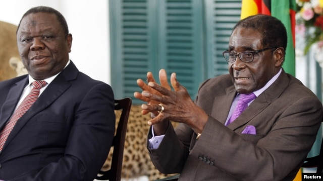 Zimbabwean President Robert Mugabe (R) and Prime Minister Morgan Tsvangirai address a media conference at State House in Harare, January 17, 2013.