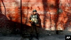 FILE - An Indian paramilitary soldier stands guard in Srinagar, Indian-controlled Kashmir, Jan. 25, 2015.