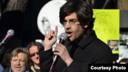 Demand Progress founder and director Aaron Swartz protesting against Stop Online Piracy Act (SOPA) bill, January 18, 2012. (Daniel J. Sieradski/Creative Commons)