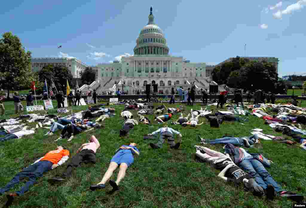 Activists mark the second anniversary of the Pulse Nightclub shooting where a gunman killed 49 people in Orlando with a die-in at the U.S. Capitol in Washington, D.C., June 12, 2018.