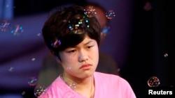 Lý Thiên Nhất, 17 tuổi, bị tuyên án 10 năm tù vì can tội cưỡng hiếp tập thể.