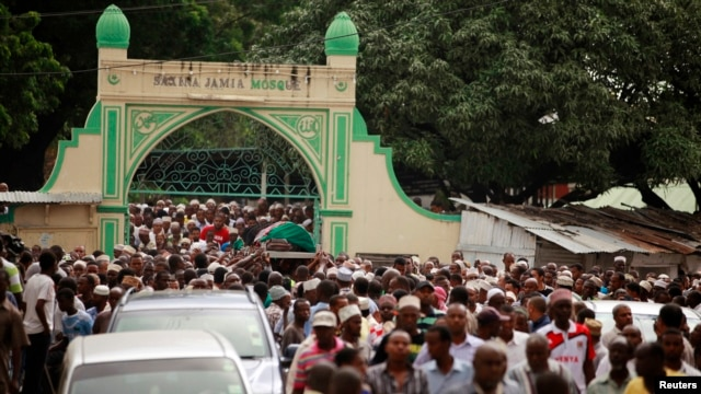 FILE - Muslims faithfuls carry a coffin with the body of Sheikh Mohammed Idris, chairman of the Council of Imams and Preachers of Kenya (CIPK), who was gunned down by assailants near his home in Mombasa, June 10, 2014.