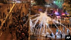 防暴警察對示威學生使用催淚瓦斯。
