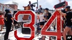 Retired Boston Red Sox designated hitter David Ortiz addresses a gathering, where part of Yawkey Way was renamed David Ortiz Drive.