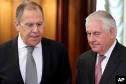U.S. Secretary of State Rex Tillerson and Russian Foreign Minister Sergei Lavrov enter a hall prior to their talks in Moscow, April 12, 2017.