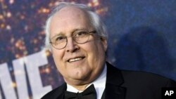 FILE - Chevy Chase attends the SNL 40th Anniversary Special at Rockefeller Plaza in New York.