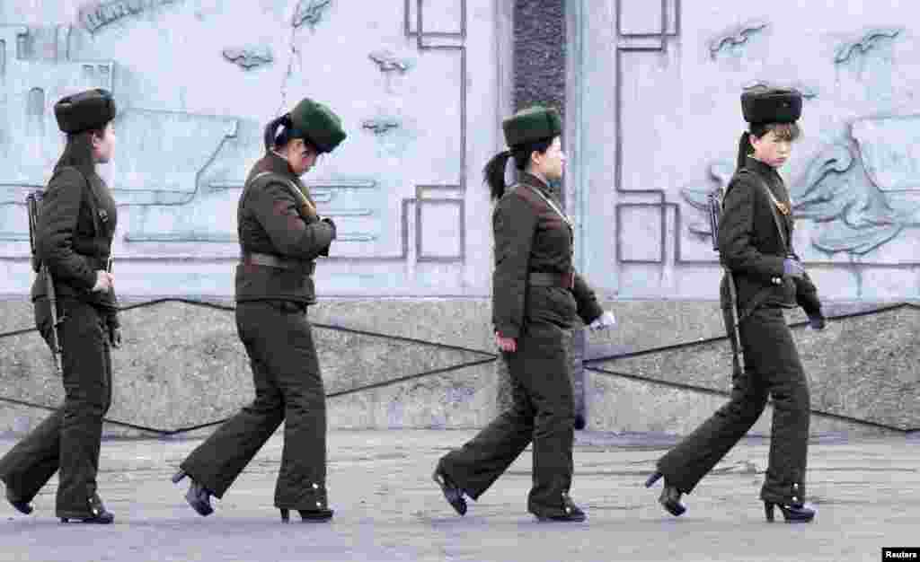 Female North Korean soldiers patrol along the banks of Yalu River, near the North Korean town of Sinuiju, opposite the Chinese border city of Dandong, April 11, 2013.