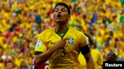 Brazil's Thiago Silva celebrates after scoring against Colombia during their 2014 World Cup quarterfinals at the Castelao arena in Fortaleza, July 4, 2014.