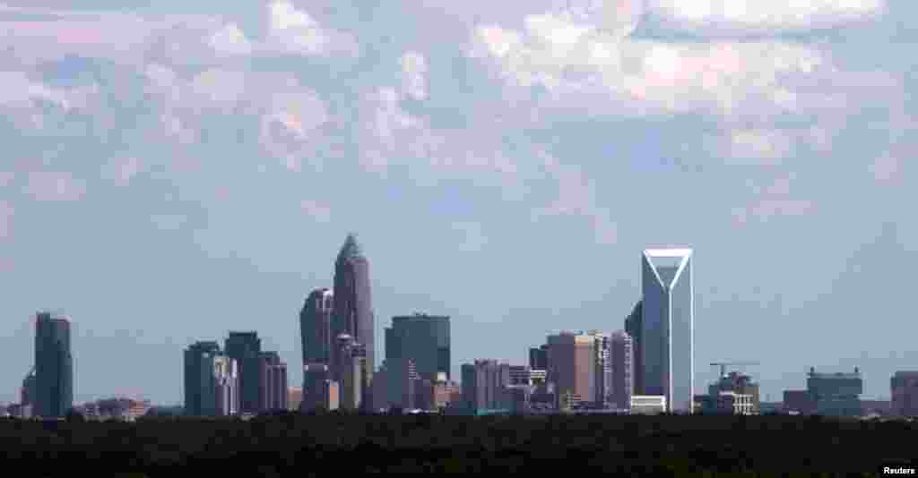 The Charlotte, North Carolina skyline seen through the window of an airplane, September 2, 2012.