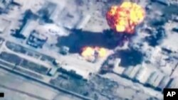 In this image made from undated video provided by Jordanian military via Jordan TV, explosions go off as the military carried out airstrikes at an undisclosed location in Syria. The military carried out airstrikes on Islamic State weapons depots and train