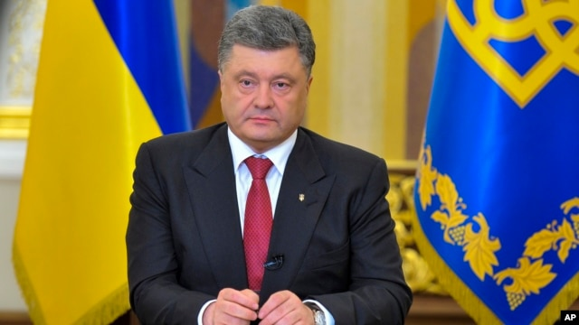 FILE - Ukrainian President Petro Poroshenko makes a televised address in Kyiv, June 30, 2014.