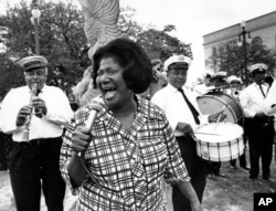 """Mahalia Jackson sings """"Just a Closer Walk with Thee"""" to the beat of the Eureka Brass Band at the first New Orleans Jazz Festival on April 23, 1970."""