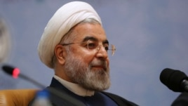 FILE - Iranian President Hassan Rouhani sits while attending the 27th International Islamic Unity Conference in Tehran, Iran, Jan. 17, 2014.