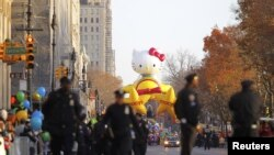 Police walk along Central Park West as the Hello Kitty balloon waits for the start of the 86th Macy's Thanksgiving Day Parade in New York, November 22, 2012.