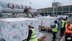 Officials receive boxes of Moderna coronavirus vaccine at the airport in Nairobi, Kenya, Sept. 6, 2021.