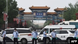 Chinese police guard the entrance to the closed Xinfadi market in Beijing on June 13, 2020.