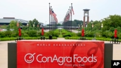 FILE - Flags fly over ConAgra Foods world headquarters in Omaha, Nebraska, June 30, 2015. ConAgra Foods moved 1,000 jobs in 2016 from Omaha to Chicago.