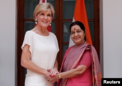 Australian Foreign Minister Julie Bishop shakes hands with her Indian counterpart Sushma Swaraj (R) during a photo opportunity ahead of their meeting at Hyderabad House in New Delhi, India, July 18, 2017.