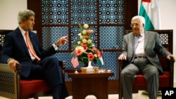 FILE - U.S. Secretary of State John Kerry (L) meets with Palestinian President Mahmoud Abbas.
