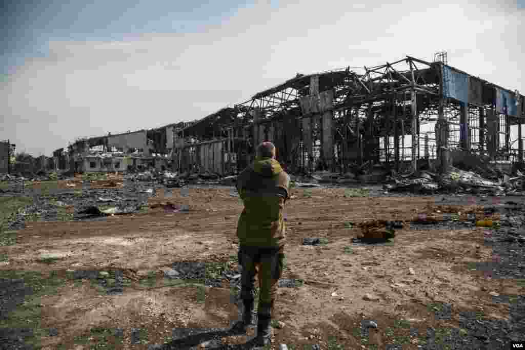 A pro-Russian fighter walks through what remains of the rebel-held Donetsk airport, after intense fighting. (Adam Bailes/VOA)