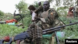 Ugandan soldiers serving with African Union Mission in Somalia take a break during patrols in Lafole village, near Afgoye district in Mogadishu, May 27, 2012.