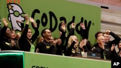 GoDaddy CEO Blake Irving joins the celebration during New York Stock Exchange opening bell ceremonies for his company's IPO, April 1, 2015. GoDaddy is one of the internet companies to begin to police hate speech online.