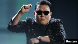 South Korean pop artist Psy performs 'Gangnam Style' at the 40th American Music Awards in Los Angeles, California, November 18, 2012.