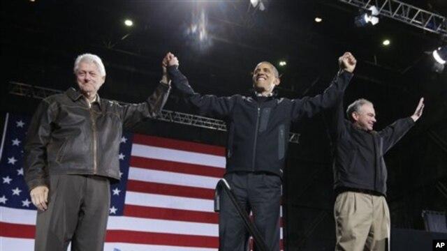 President Obama ari kumwe na president Clinton, imbere y'uko batangura ikoraniro